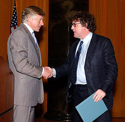 Columbia University President Lee C. Bollinger (left) presents Paul Muldoon with the 2003 Pulitzer Prize in Poetry. source pulitzer.org
